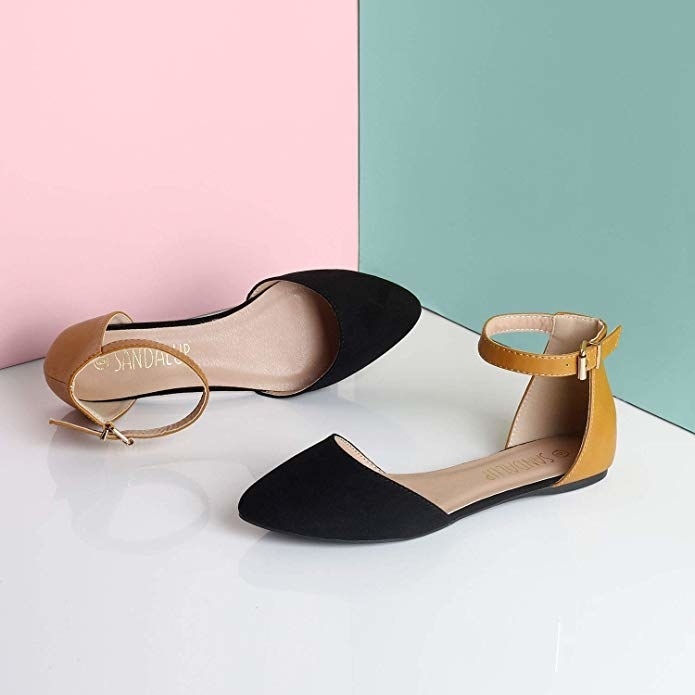 the flat with black pointed toe and yellow heel and ankle strap