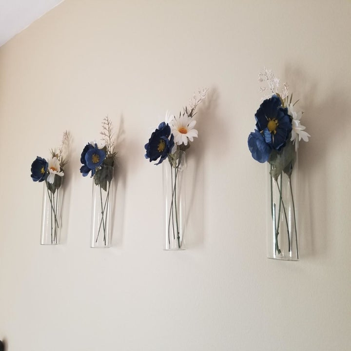 reviewer image of multiple vases with flowers on the wall