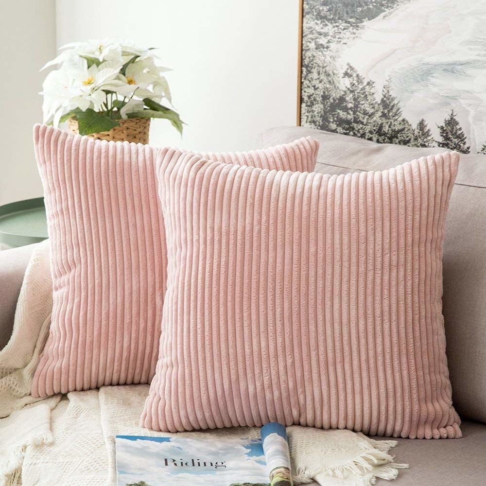 Pillows with pastel pink corduroy covers on them