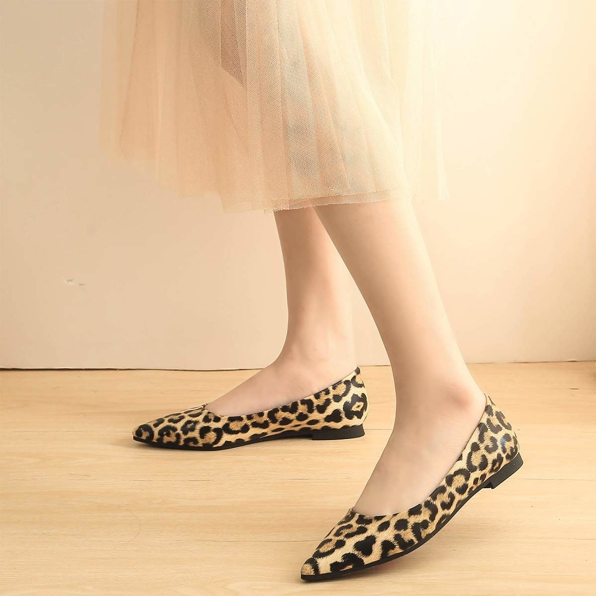 the pointed-toe flat with black and light brown leopard print