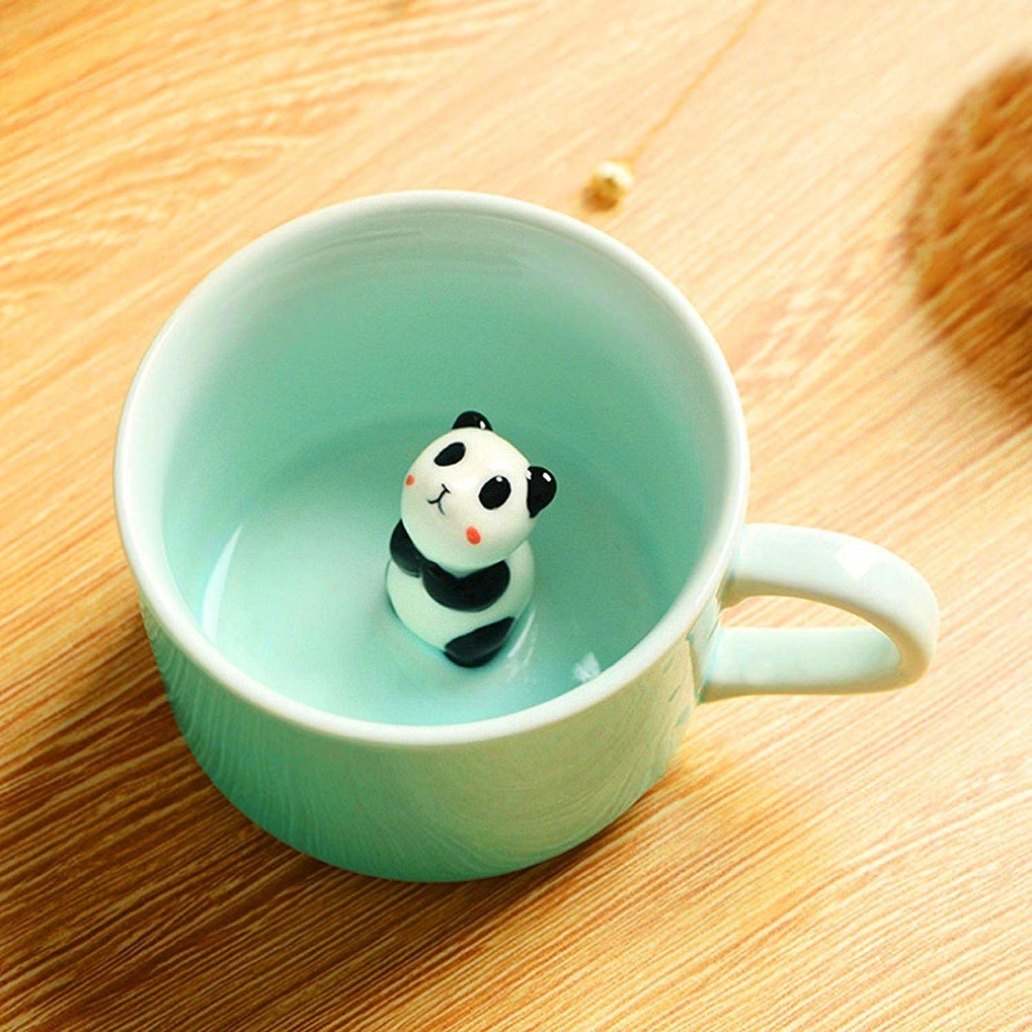 Mug with an adorable panda looking up from the bottom.