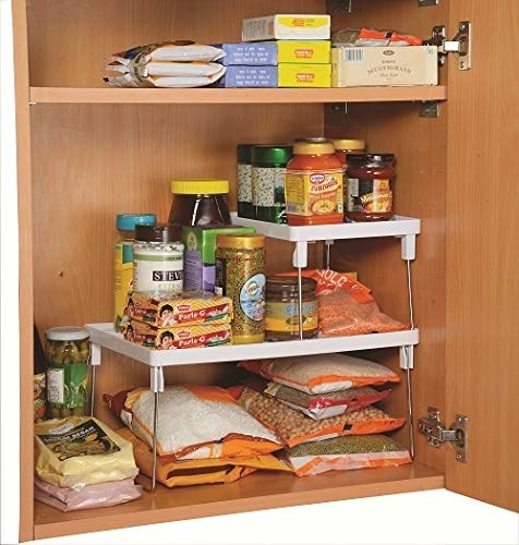 Cupboard arranged with the folding rack inside.