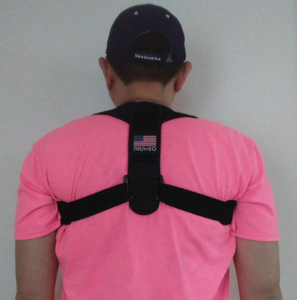 back strap on a reviewer's back. it goes over the shoulders like a backpack.