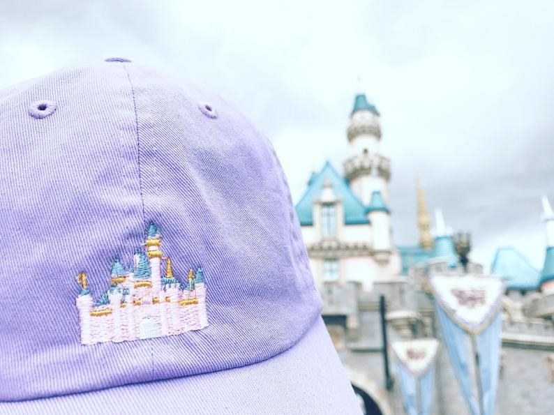 pastel lavender baseball hat with cinderella castle embroidered on it