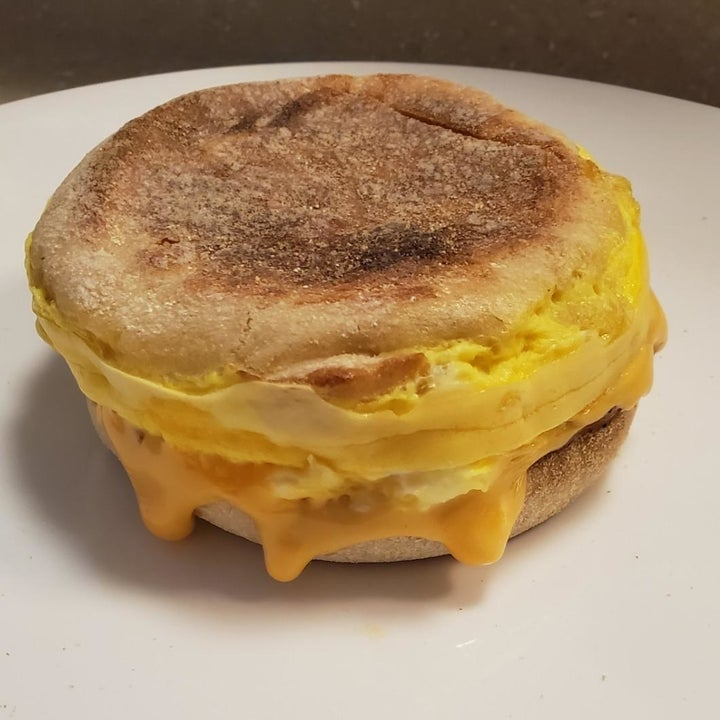 A finished breakfast sandwich with egg and cheese