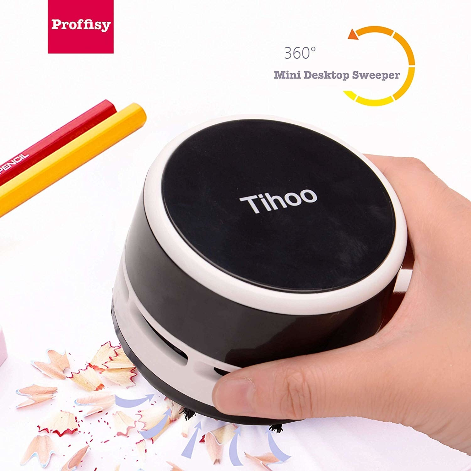 Pencil shavings being vaccuumed off a desk with a black desk vaccuum