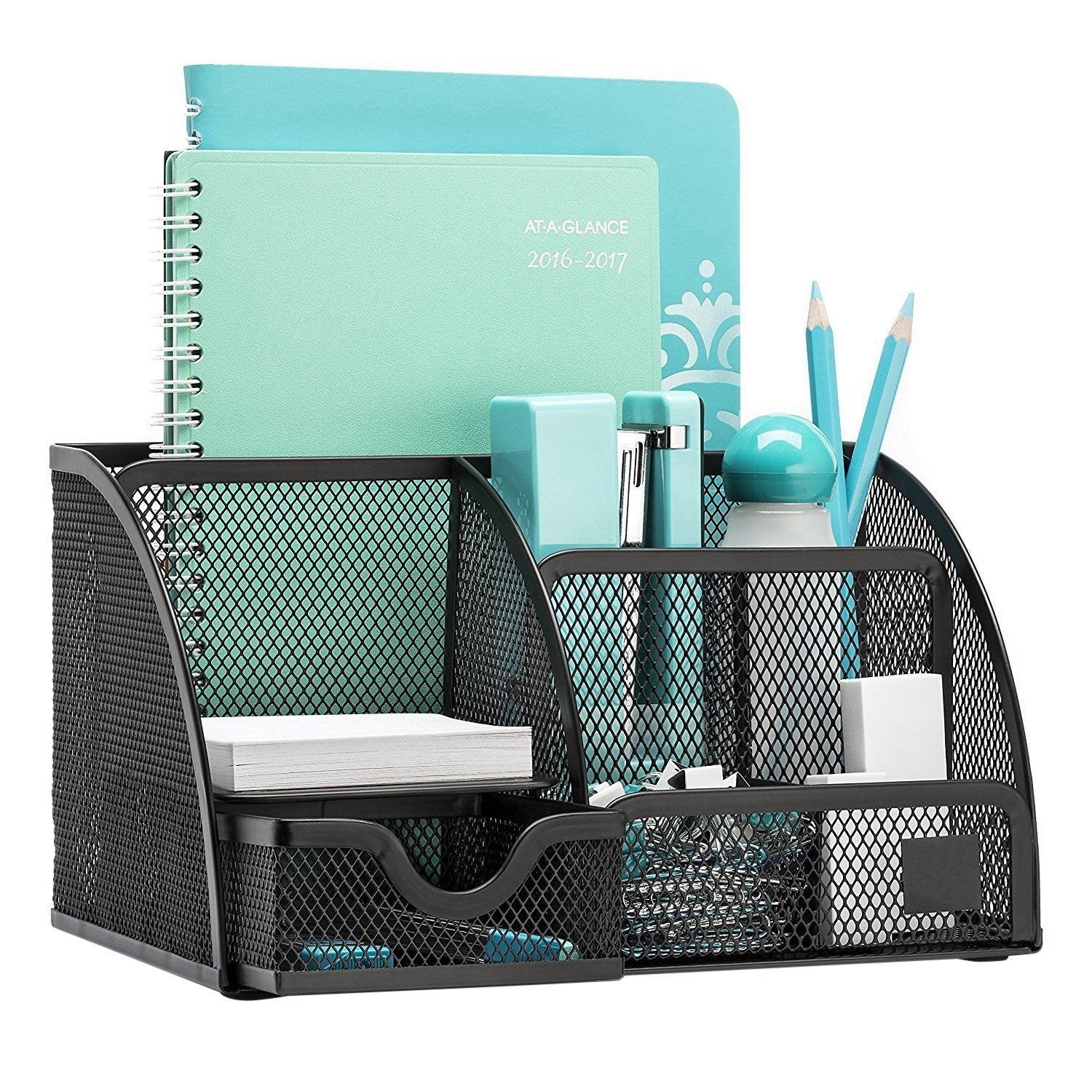 A black desk organiser with stationery and notebooks kept in it