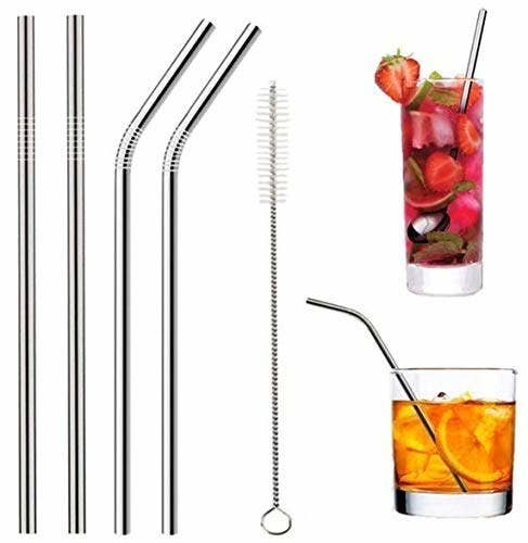 Two straight metal straws, two bent metal straws, a cleaning brush, and two glasses of drinks with metal straws in them
