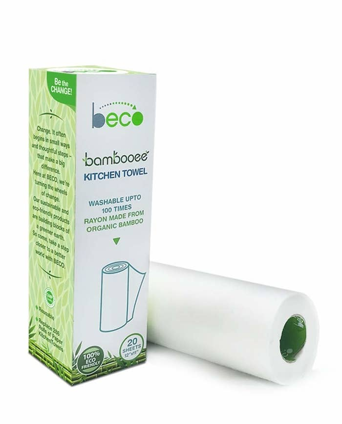A roll of bamboo kitchen towels lying next to its box