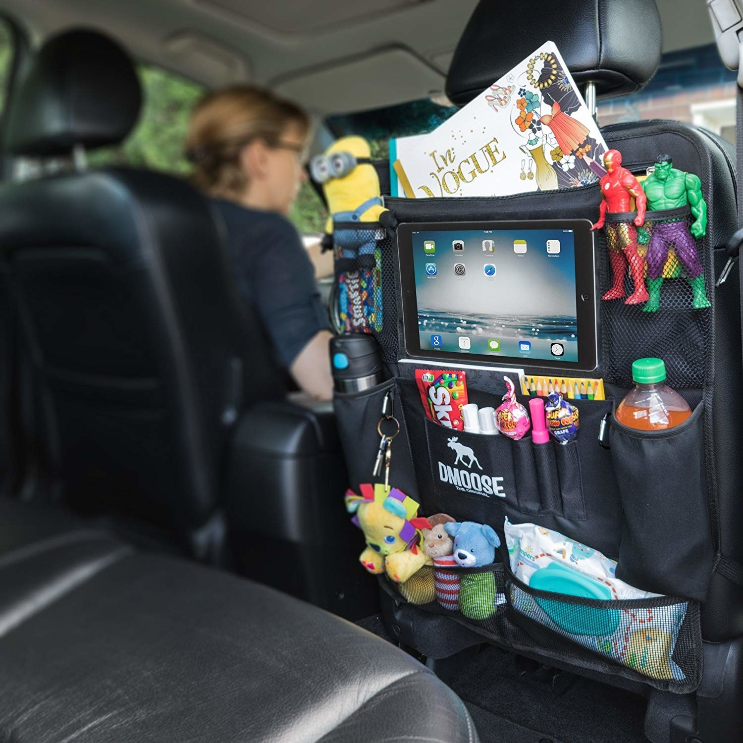A back seat organizer with toys, wipes, an iPad, books, etc.