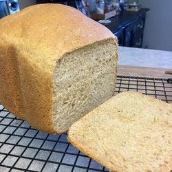 A loaf of baked bread sliced