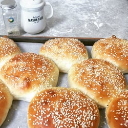 Bread rolls baked with sesame seeds on them