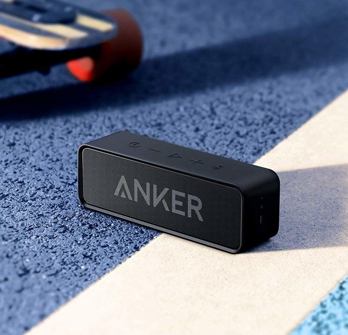The Anker speaker sitting on concrete