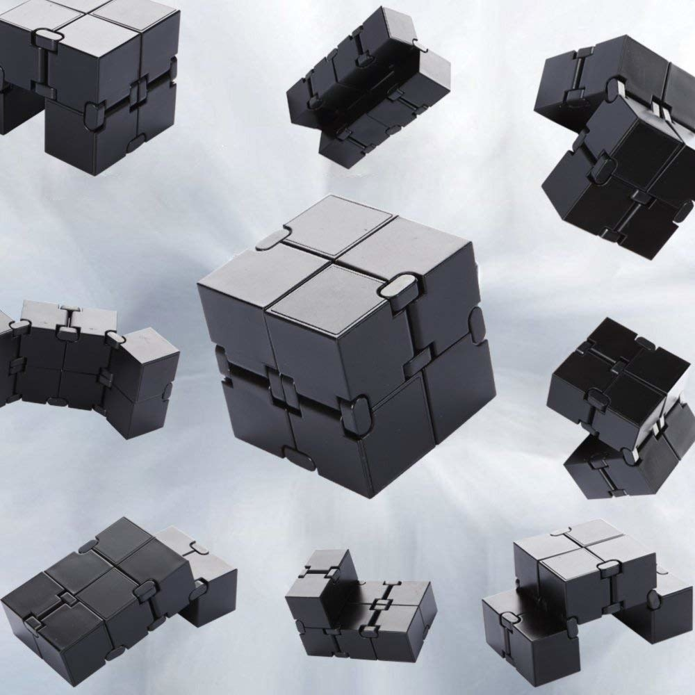 An infinity cube surrounded by floating pieces