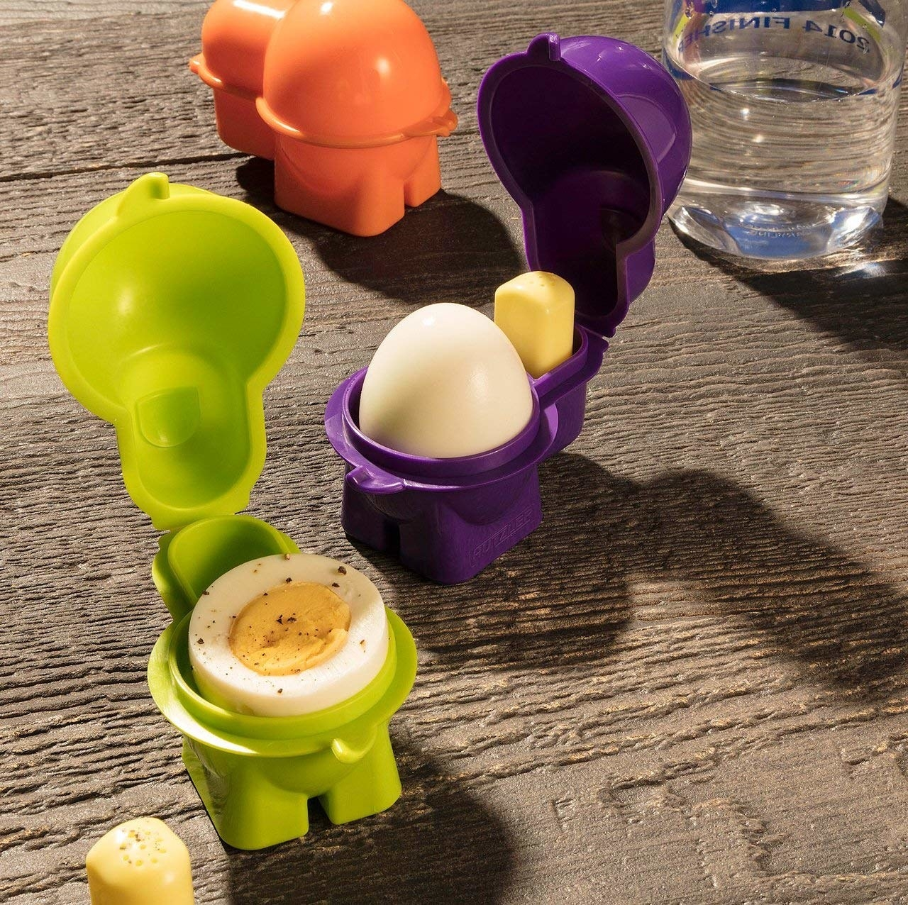 Three egg containers with eggs in them