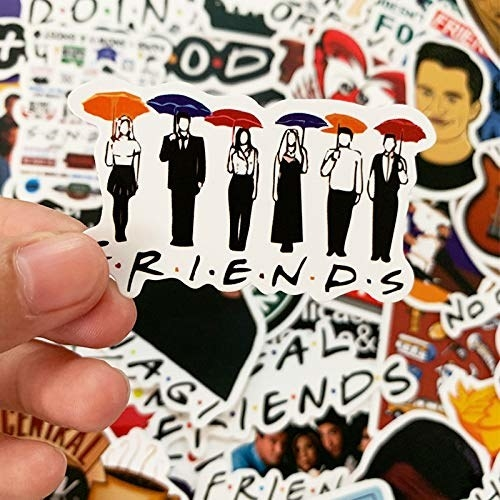 A pile of Friends stickers with one on top featuring all the Friends holding umbrellas