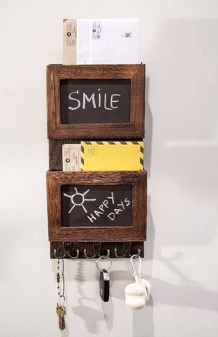 the two teir mail slot with the words smile and happy days written on the chalkboards