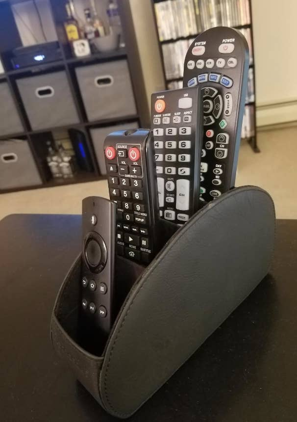 a reviewer's photo of the remote organizer filled with remotes