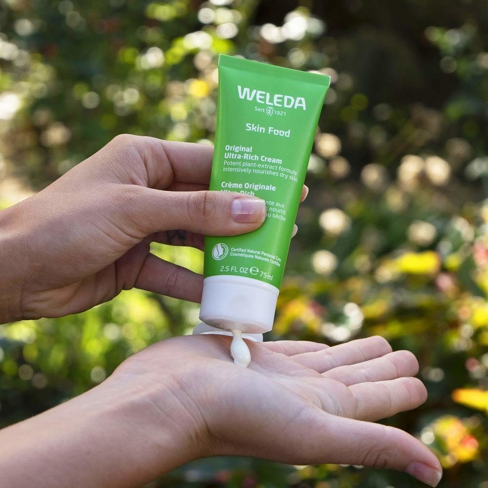 person squeezing some of the product into their open palm