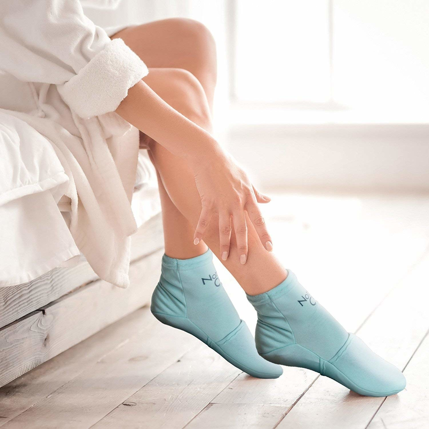 A person wearing the cold socks and touching their leg