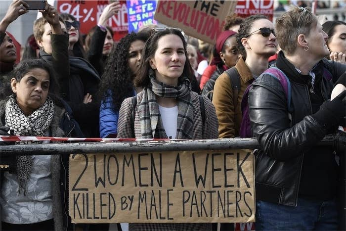 A woman seen holding a placard during the Million Women's Rise march in London.