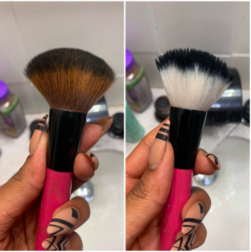 A reviewer holding a makeup brush that is brown with powder, then the same brush clean and white