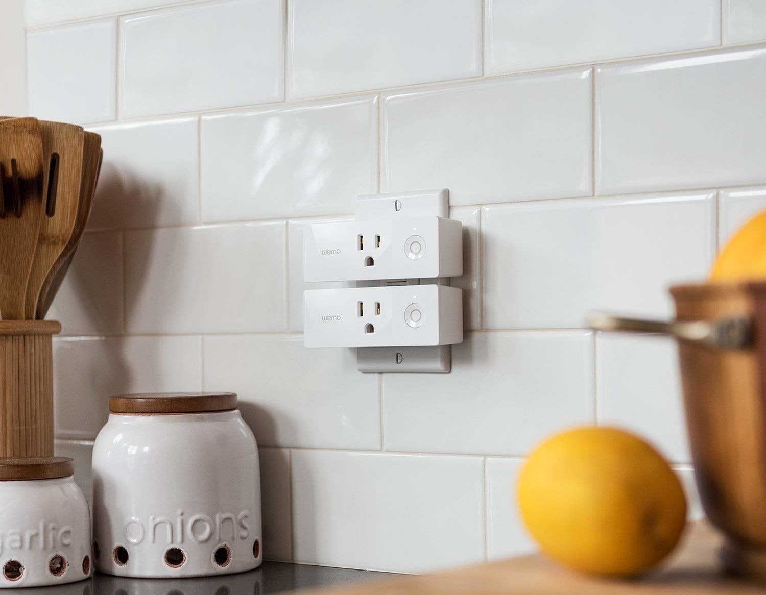 Two smart plugs in a kitchen outlet