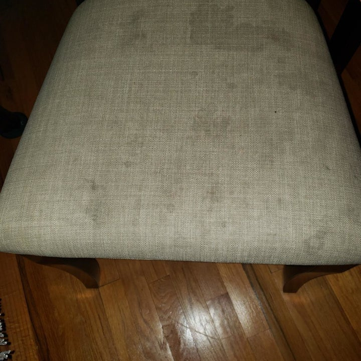 white upholstered chair with stains