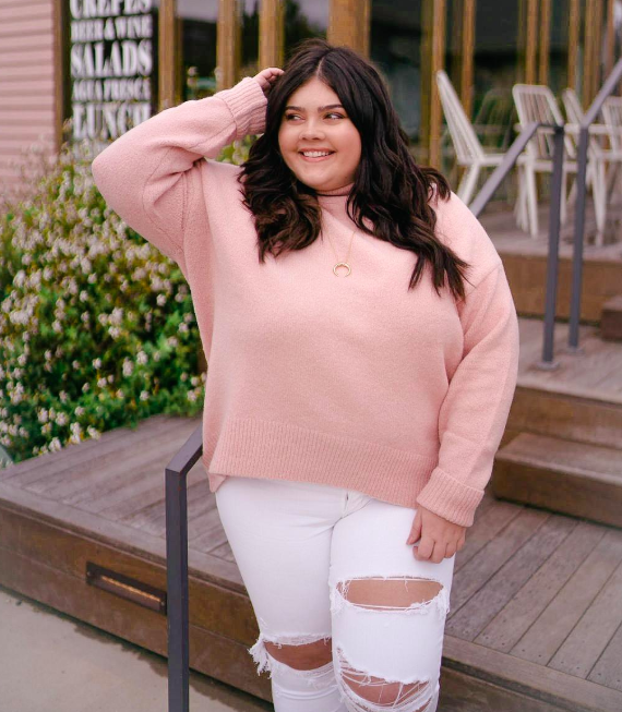 Reviewer wearing the sweater in light pink