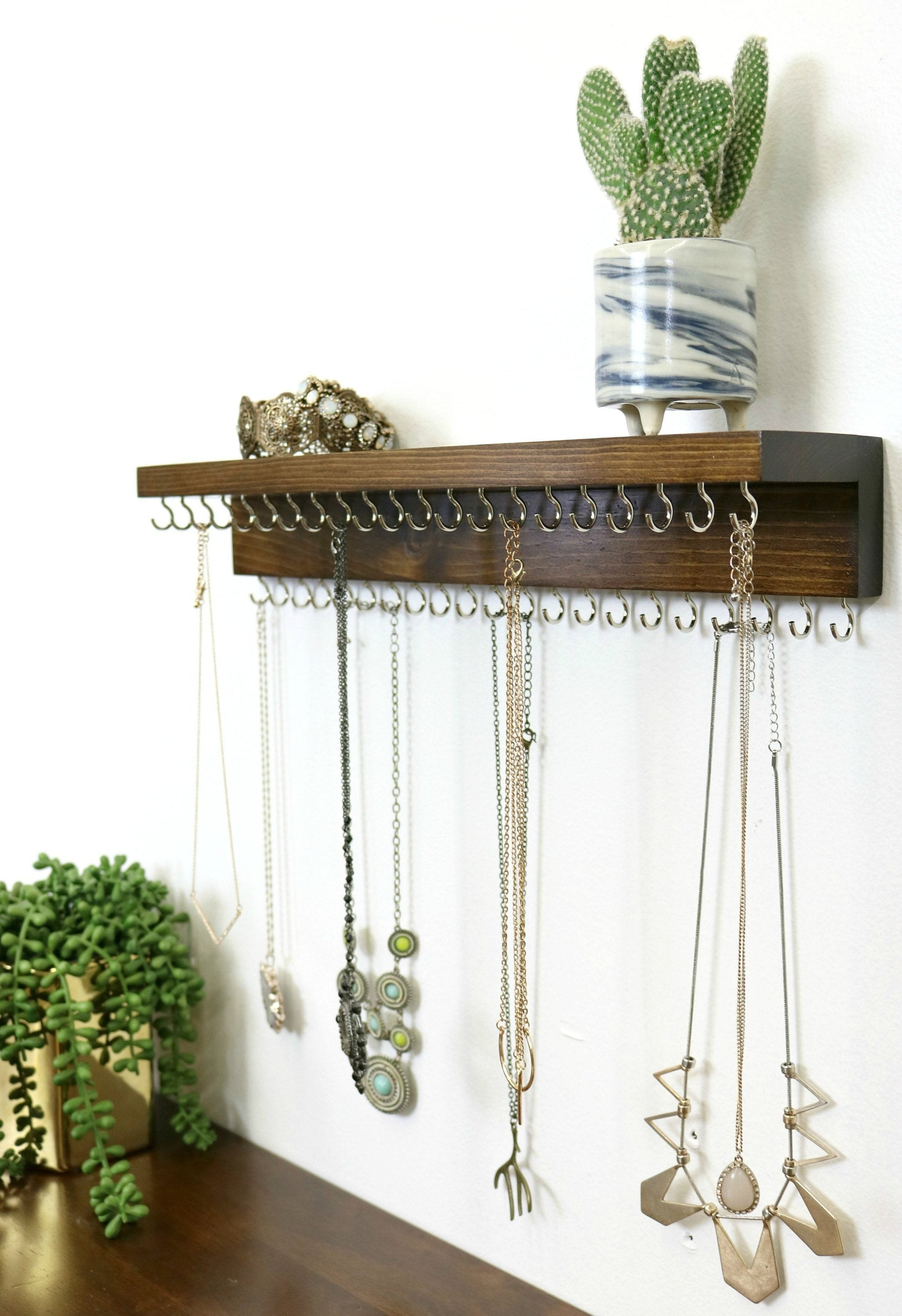 The jewelry organizer with necklaces on the hooks
