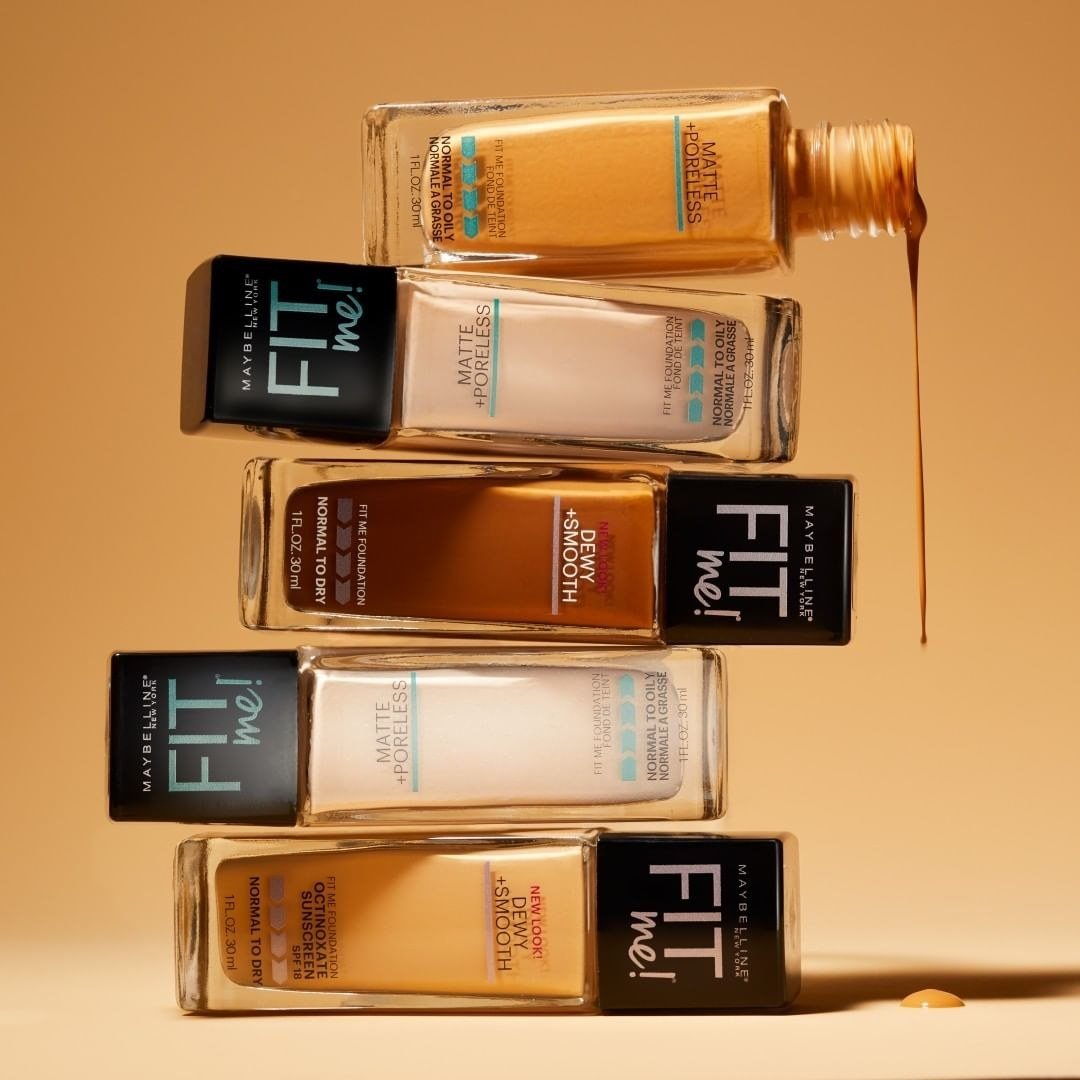 Five glass bottles of foundation in a stack