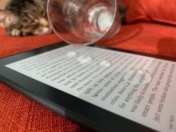 A side view of a Kindle that has spilled water on it to show that it's waterproof