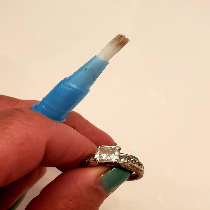 reviewer image of the brush stick next to a clean ring