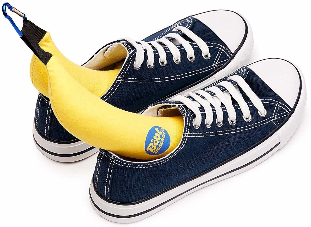 The bananas carabiner clipped together on top, each in one sneaker