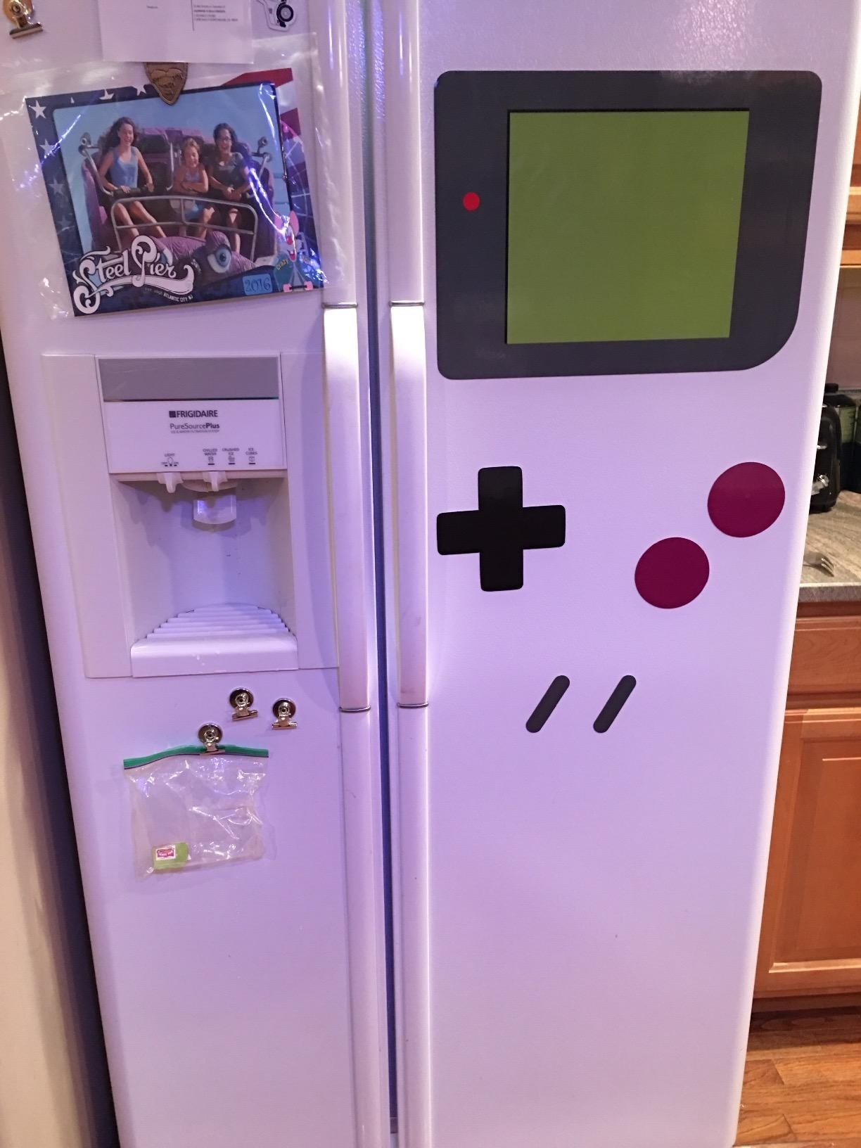 Magnets that have been arranged to make the fridge look like a Gameboy