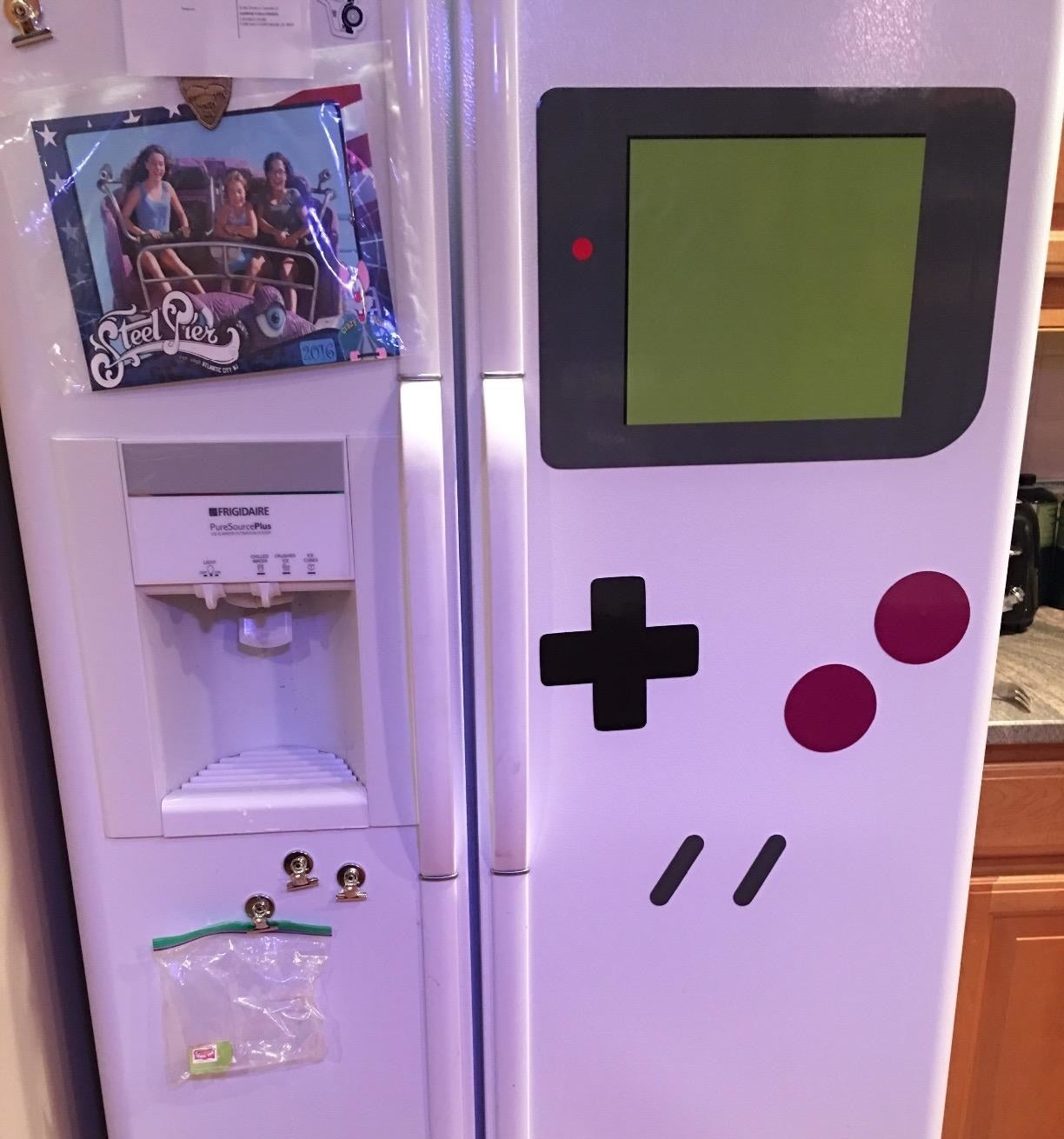The kitchen magnets arranged to make the side of a fridge look like a game boy