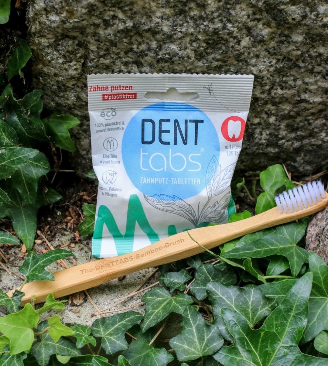 bag of dental tabs next to toothbrush