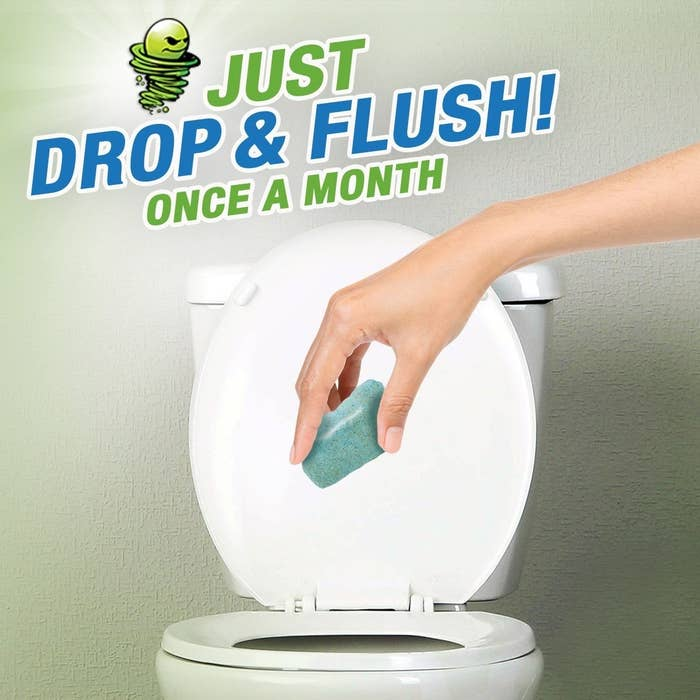 hand drops green square in toilet