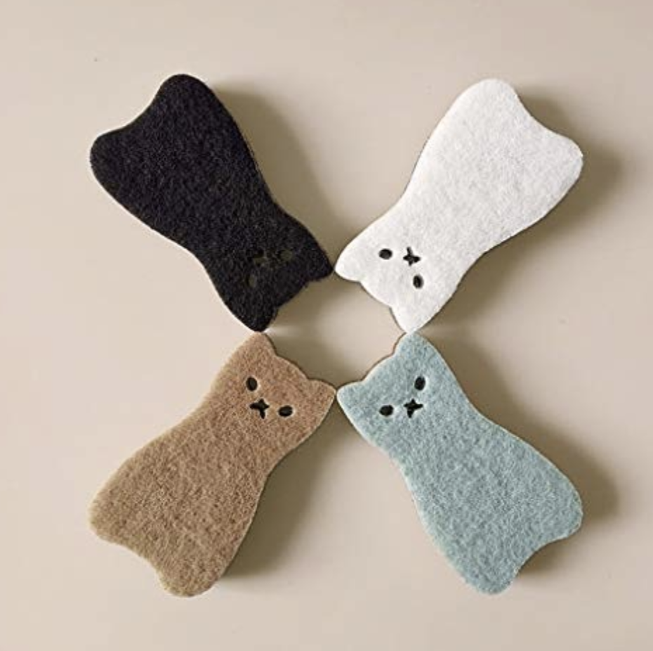 Set of four brown, black, white, and light blue cat scrubbers in a circle