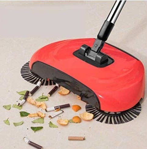 Dusting mop in action as it easily collects cigarette buds and other trash in front of it.