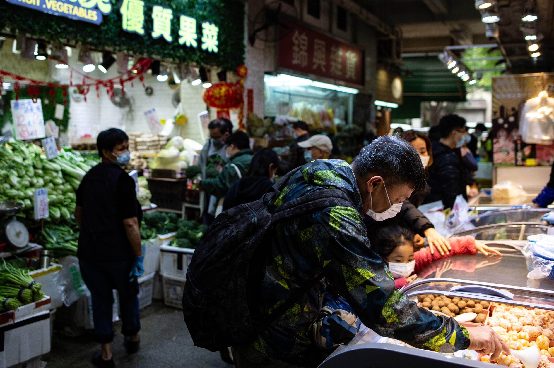 People wearing face masks in a wet market as residents in Mei Foo district.
