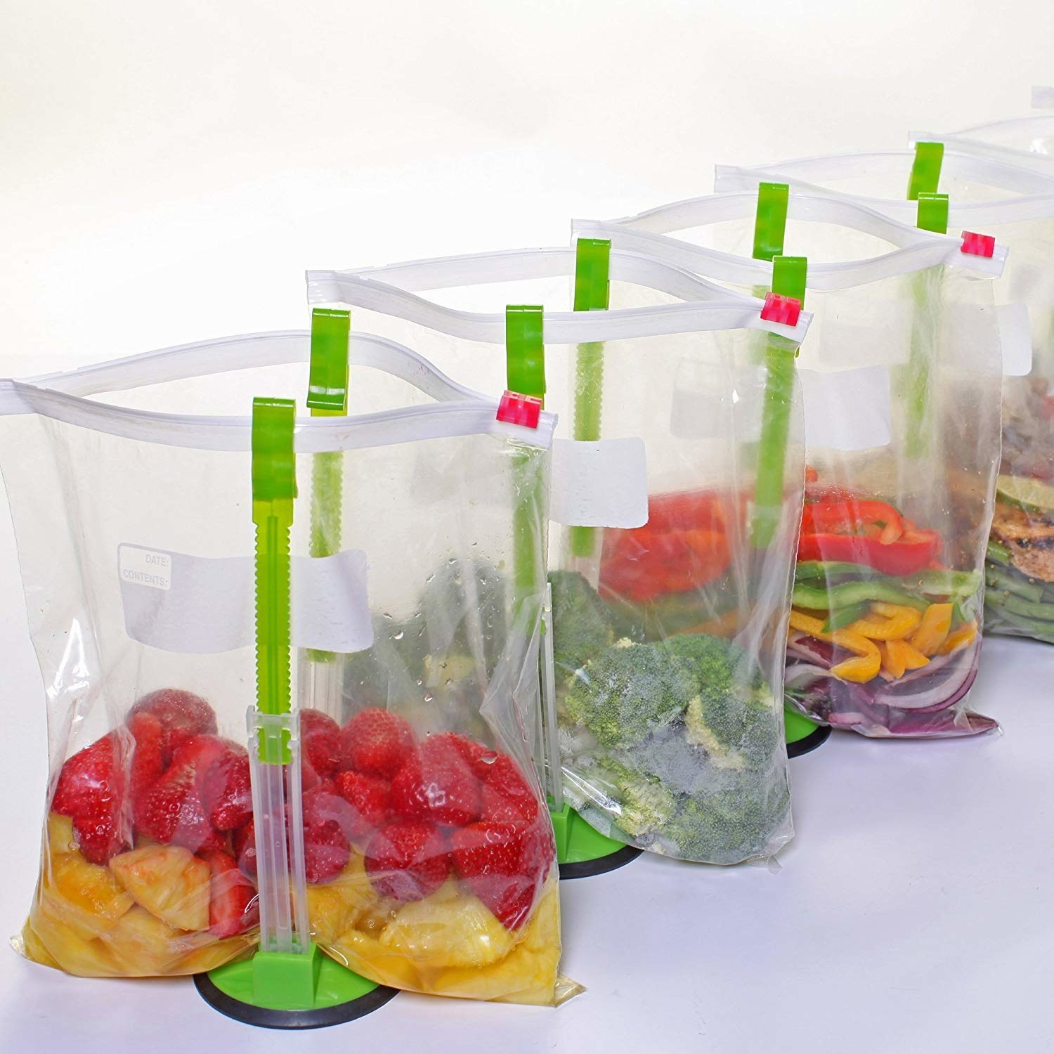 Three V-shaped plastic bag holder with clips at the tops and a wide base Three plastic bags full of fruits and veggies clipped on each side