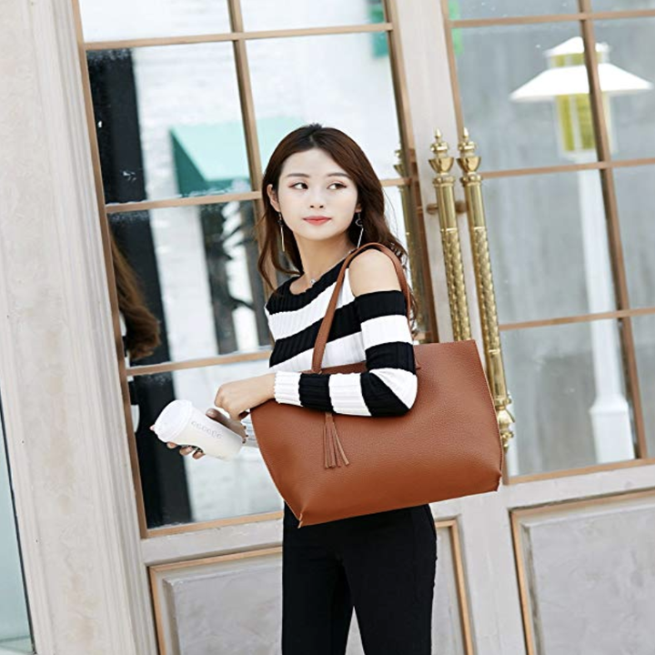 Model with camel colored tote bag