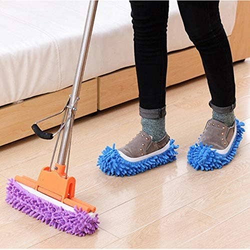 A person wearing the mop slippers and cleaning the floor.