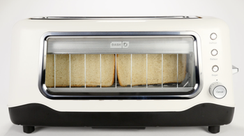 White toaster with glass at sides to show the bread inside
