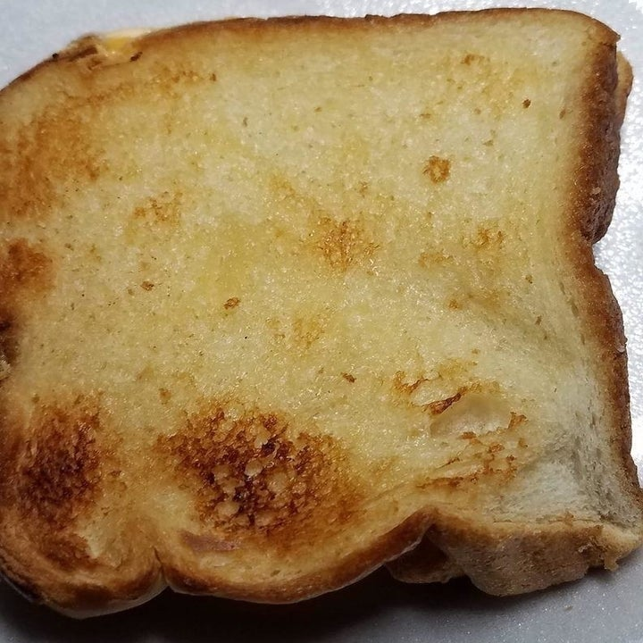 a reviewer photo of a grilled cheese that was made using the toaster bags