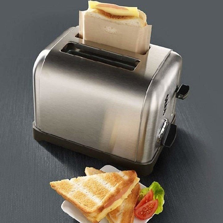 a grilled cheese inside the toaster bag inside a toaster