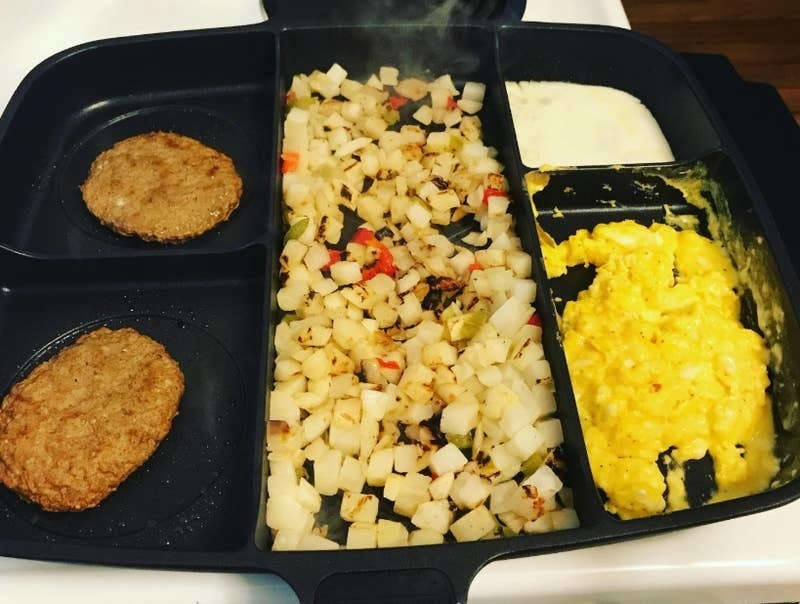 a reviewer photo of the divided skillet cooking various breakfast foods