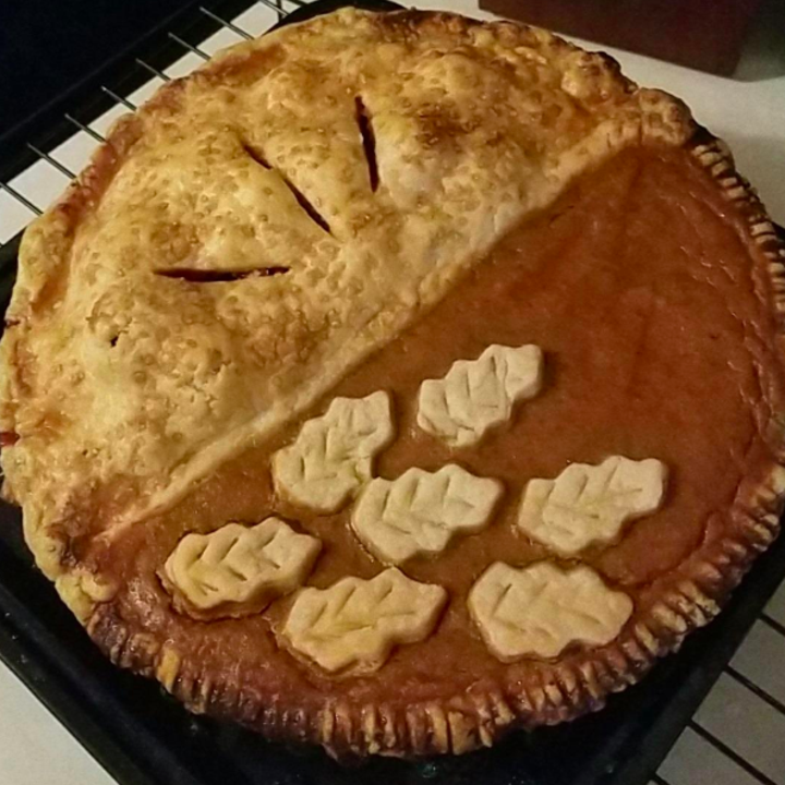 a reviewer photo of a split decision pie they made in the pan