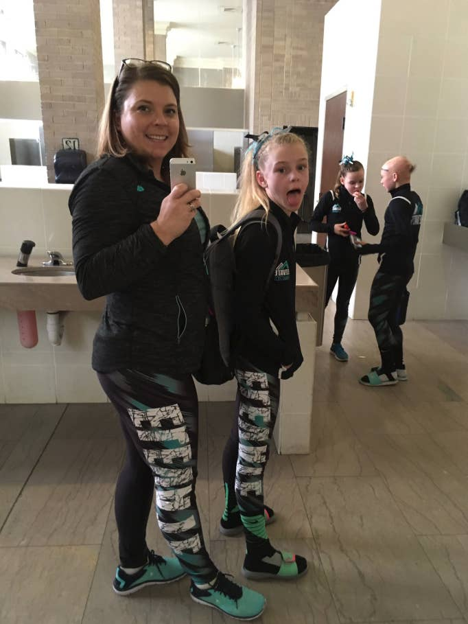 Nicole Clemens with her daughter posing in matching sportswear